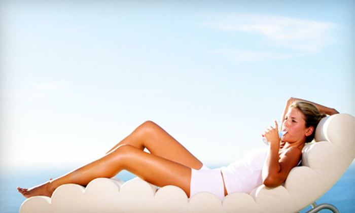 Kristi & Charlis - Hayden: Summer Special Package with Spray Tan or Hair Services at Kristi & Charlis in Hayden (Up to 52% Off)