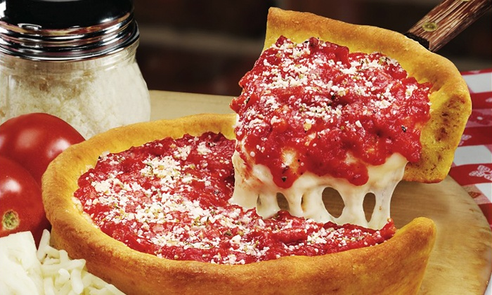 Gino's East - Multiple Locations: $16 for $30 Worth of Deep-Dish Pizza and Other Menu Items at Gino's East