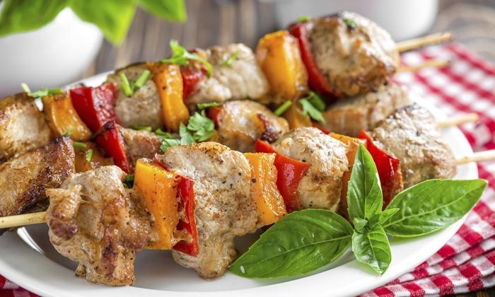 Greek Village Restaurant - Schaumburg: $17 for $30 Worth of Seafood, Mediterranean Cuisine and Drinks During Dinner at Greek Village Restaurant