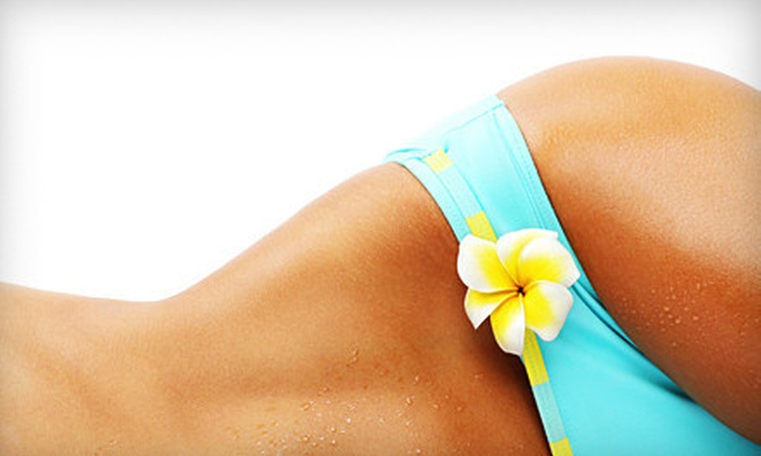 Soleil Tanning Boutique - Multiple Locations: 30 Days of Unlimited UV Tanning or Four Mystic Tans at Soleil Tanning Boutique (Up to 75% Off)