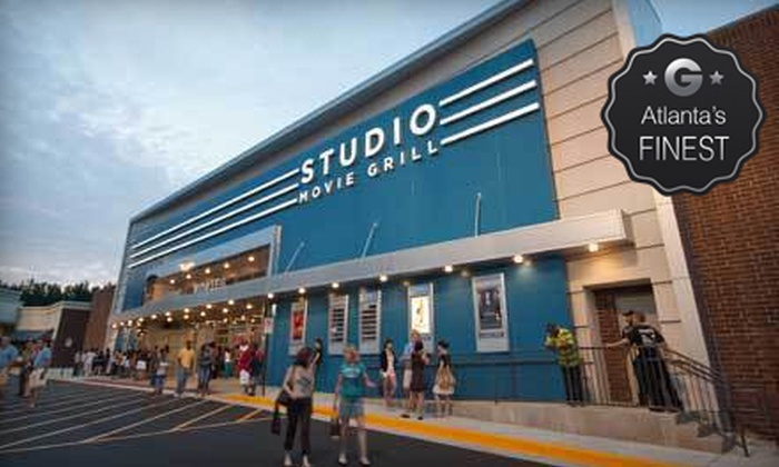 Studio Movie Grill - Holcomb Bridge: $5 for a Movie and Soda at Studio Movie Grill (Up to $12.74 Value)