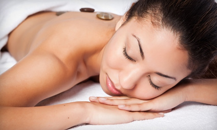 REJUVENATE Wellness - Portage: $75 for a 75-Minute Hot-Stone Massage with Aromatherapy, Reflexology, and Hot Towels at Rejuvenate Wellness ($155 Value)