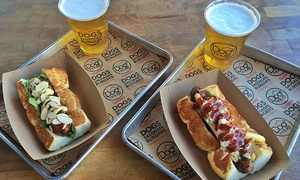 Dog Haus Canoga Park: Haus Sausage or Haus Dog with Pints of Beer for Two or Four at Dog Haus Canoga Park (Up to 34% Off)