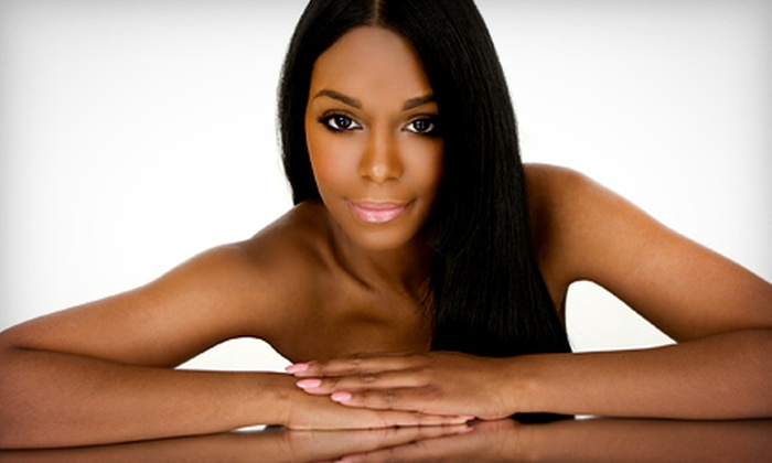 Premier Salon and Spa - East Louisville: $29 for a Mizani Relaxer Hair Treatment at Premier Salon and Spa ($60 Value)