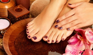 Deluxe Nail & Beauty: Manicure and Spa Pedicure for One ($29) or Two People ($57) at Deluxe Nail & Beauty (Up to $140 Value)