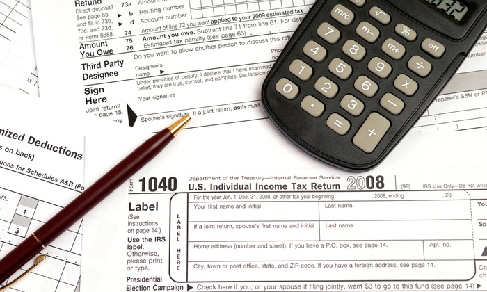 Khan Tax Services - Garden City: Complete Individual or Small Business Tax Return Preparation at Khan Tax Services (66% Value)