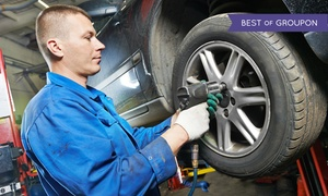 Tucker Auto Service Inc.: Two or Four Wheel Alignment with Tire Rotation and Brake Inspection at Tucker Auto Service Inc. (Up to 64% Off)
