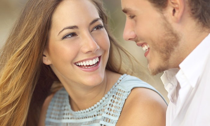 Premier Dentistry - South Charlotte: Invisalign Treatment Package or Zoom Teeth Whitening with a Dental Exam at Premier Dentistry (Up to 56% Off)