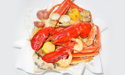 Seafood or One Big Cajun Seafood Bucket Plus Calamari and One Bottle of Wine at Lobster Grill (Up to 43% Off)