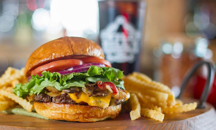 Wild Bill's Sports Saloon - Multiple Locations: Burgers, Wings, and Beer at Wild Bill's Sports Saloon (Up to 52% Off). Two Options Available.
