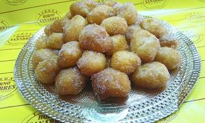 Horno Sanabrés: Bandeja de buñuelos rellenos de crema, nata o trufa de medio kilo por 9,90 € o de un kilo por 16,90 €