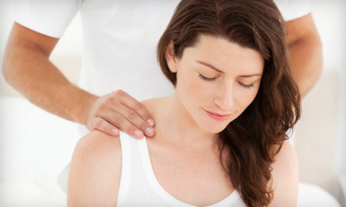 InTouch Wellness Center - InTouch Wellness Center: Four or Six Spinal-Decompression Treatments with Warm-Up Massages at InTouch Wellness Center (90% Off)