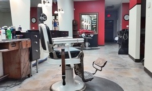 Grand Cuts: One or Two Men's Haircut or One Kid's Cut at Grand Cuts (Up to 50% Off)