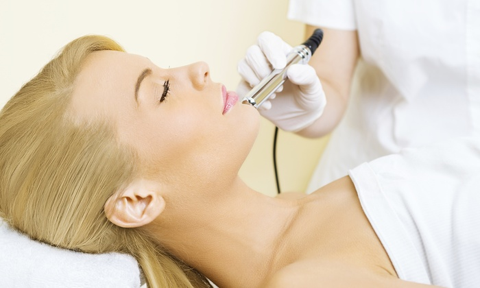 Pure Laser USA - Multiple Locations: One, Three, or Five Microdermabrasion Treatments with Vitamin C Masks at Pure Laser USA (Up to 51% Off)