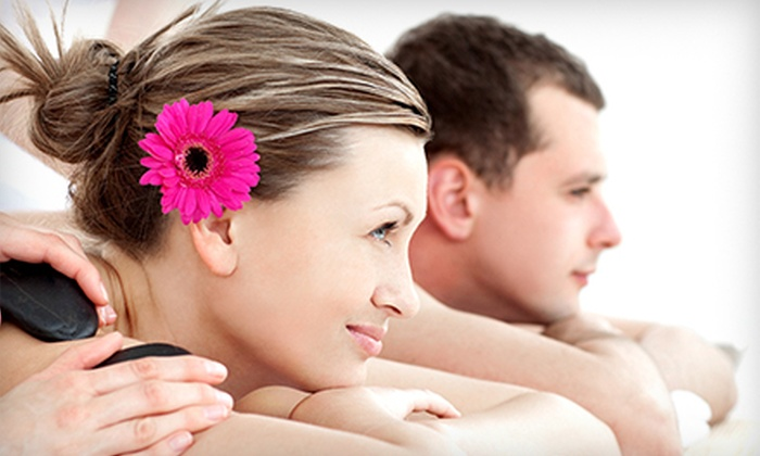 SunSera Salons - Multiple Locations: Hot-Stone Massages at SunSera Salons (Up to 55% Off). Three Options Available.
