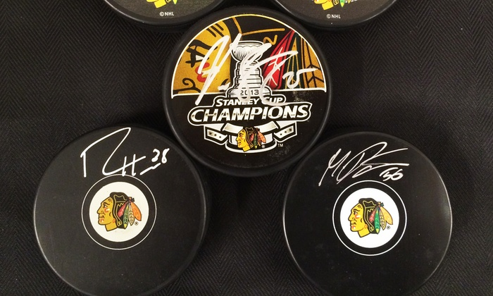 Sideline Marketing - Sideline Memorabilia Store: Signed Blackhawks Hockey Puck from Sideline Marketing & Sports Memorabilia (50% Off). Seven Options Available.
