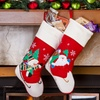 Two Christmas Stockings with Santa and Snowman Design