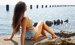 Two Spray Tans or One Month of Unlimited UV Tanning or Spray Tans at Edge Tanning (Up to 73% Off)