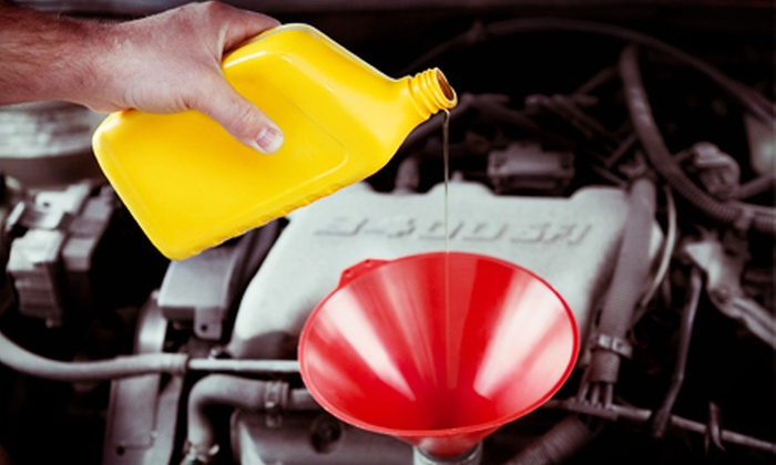 Tuffy Auto Service Center - Two Cambridge Commons Condominiums: One or Three Oil Changes at Tuffy Auto Service Center (Up to 64% Off)