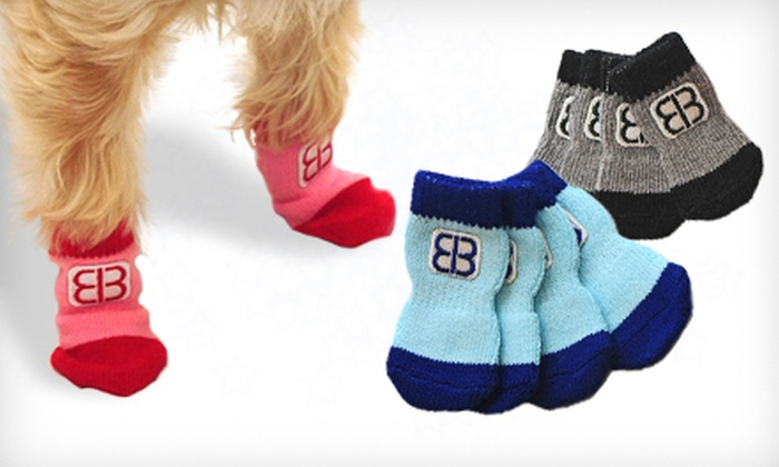 Pet Ego Traction-Control Socks: $9.99 for Two-Pack of Pet Ego Traction-Control Socks (Up to $18 List Price). Multiple Colors and Sizes Available.