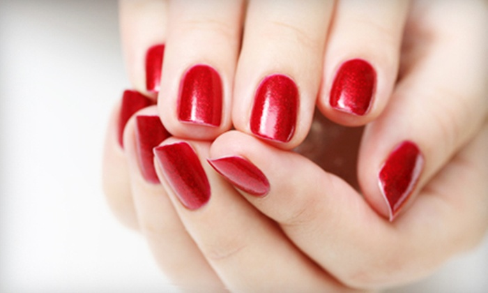 Ossia Salon and Spa - Waterloo: Ossia Classic Manicure with Optional Gel Polish and Eyebrow Wax at Ossia Salon and Spa (Up to 52% Off)