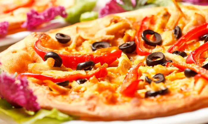 Georgio's Pizza - Downtown East Lansing: $25.50 for Three Groupons, Each Good for $15 Worth of Gourmet Pizza at Georgio's Pizza ($45 Total Value)