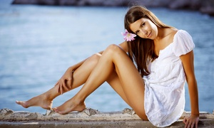 Caribbean Tanz: Level 1 Tanning, Stand-Up Tanning, or Airbrush Spray-Tanning at Caribbean Tanz (Up to 77% Off)