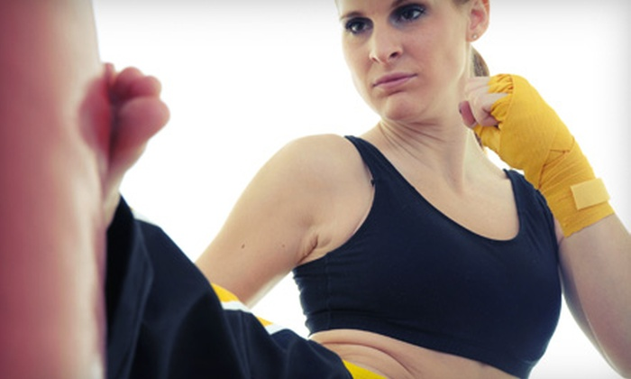 TITLE Boxing Club - Highland Heights: Two Weeks of Boxing and Kickboxing Classes for One or Two with Hand Wraps at Title Boxing Club (Up to 70% Off)