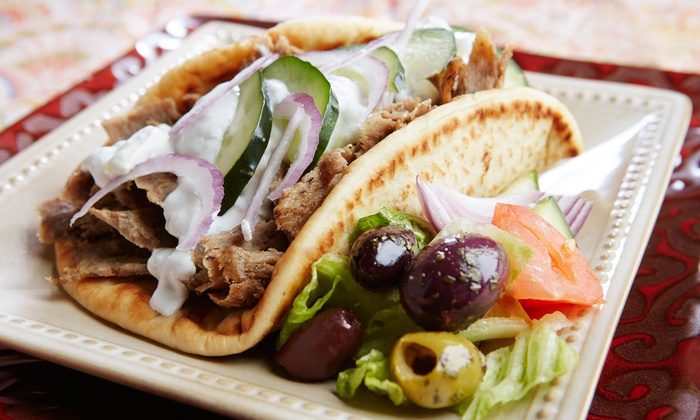 Greek Island Grill - Riverwalk: Greek Dinner Cuisine for Two or Four at Greek Island Grill (43% Off)