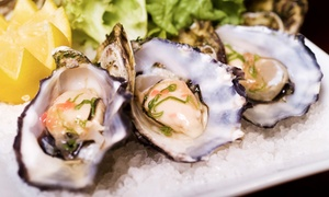 Eats on Lex: $39 for Two Dozen East Coast Blue Point Oysters and Two Martinis, Beer, or House Champagne at Eats on Lex ($102 Value)