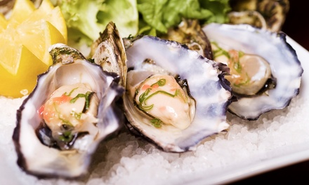 $39 for Two Dozen East Coast Blue Point Oysters and Two Martinis, Beer, or House Champagne at Eats on Lex ($102 Value)
