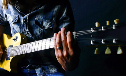 Beginner's GuitarLesson Package or One Year of Online Guitar Lessons from Center Stage Guitar Academy (Up to 86% Off)