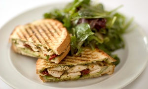 Half Time Cafe: Four Fro-Yos or Four Toasts, Sandwiches, or Wraps at Half Time Cafe (Up to 31% Off)