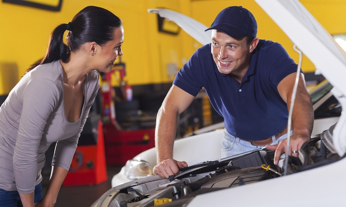 Environmental Motors Garage - Green Lake: Vehicle Tune-Up or Front or Rear Brake Repair at Environmental Motors Garage (Up to 52% Off)
