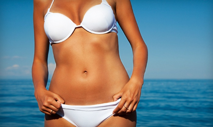 Xtreme Tan - Multiple Locations: Two Airbrush-Tanning Sessions or One Month of Unlimited UV Tanning in Any Level Bed at Xtreme Tan (Up to 68% Off)