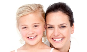 Aesthetic Dentistry: Dental Exam, X-ray and Cleaning or iBright Teeth-Whitening Treatment at Aesthetic Dentistry (Up to 89% Off)