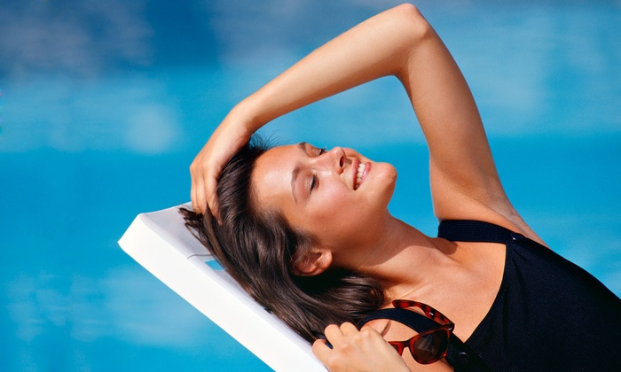 Suburban Beach Tan - Schaumburg: Custom Airbrush Tans or UV-Tanning Sessions at Suburban Beach Tan (Up to 64% Off). Two Options Available.