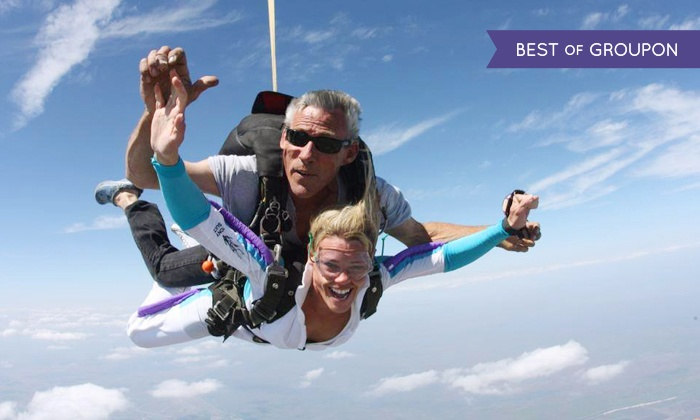 Skydive Spaceland - Clewiston: Holiday Tandem Skydive Photo Shoot Package for One, Two, or Four at Skydive Spaceland (Up to 46% Off)