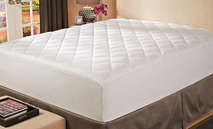 Hotel Madison Stain-Resistant Down-Alternative Mattress Pad: Hotel Madison Stain-Resistant Down-Alternative Mattress Pad. Multiple Sizes Available from $29.99–$39.99.
