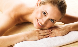 Oasis Salon and Spa: Massages with Wine and Jacuzzi Sessions at Oasis Salon and Spa (Up to 55% Off). Three Options Available.