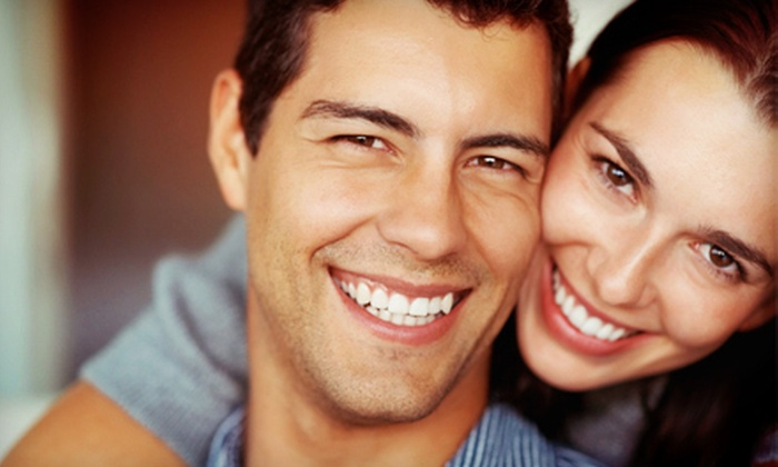 Berkshire Family Dental - Cathedral - Wesley Heights - McLean Gardens: Exam, X-Rays, and Cleaning; Custom-Fit Mouth Guard; or Dental-Implant Package at Berkshire Family Dental (Up to 81% Off)