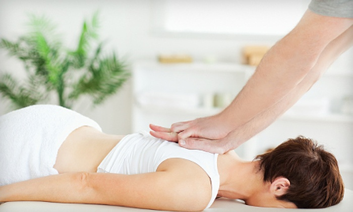 Miller Chiropractic Center - Golden Key Commerce Center: Chiropractic Exam with X-rays, Massage, and One or Four Adjustments at Miller Chiropractic Center (Up to 84% Off)