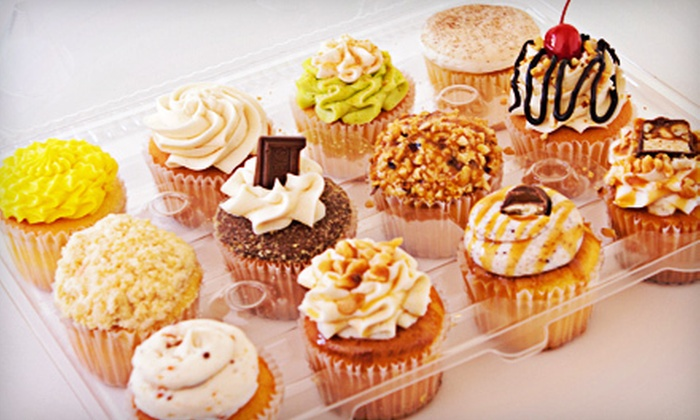 PJ's Baby Cakes - University Place: $10 for One Dozen Full-Size Cupcakes and Two French Macarons at PJ's Baby Cakes ($20 Value)