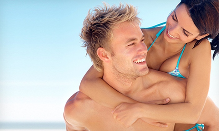 Maui Beach Tanning - Multiple Locations: One Spray Tan or One Month of Unlimited UV Tanning at Maui Beach Tanning (Up to Half Off)