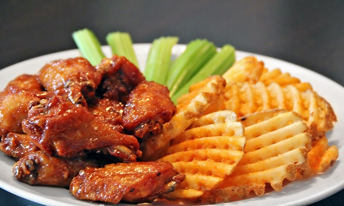 Coaches Bar & Grill - Downtown Bloomington: Lunch or Dinner for Two, or Dinner for Four at Coaches Bar & Grill (Up to 50% Off)