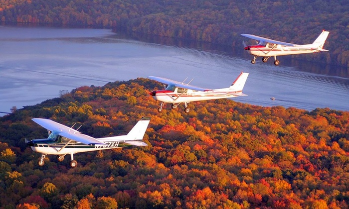 Falcon Flight Center - Multiple Locations: One 30- or 60-Minute Winter Wonderland Tour Flight for One or Two from Falcon Flight Center (Up to 47% Off)