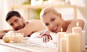 YOUNG FOREVER ESTHETIC CENTER: 60-Minute Couple's Massage with Option of Chocolate, Champagne, and Fresh Fruit (Up to 40% Off)