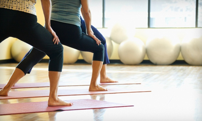 Bikram Yoga Renton - Renton: One Month of Unlimited Bikram Classes with Guest Passes at Bikram Yoga Renton (Up to 87% Off)