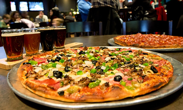 Village Inn Pizza Parlor - Millbrook: $19.99 for Pizza, Wings, and Beer on Sunday or Monday Night at Village Inn Pizza and Sports Grille (Up to $34.68 value)