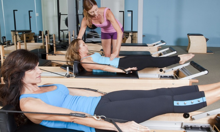 Symmetry in motion - Summerlin South: Four Weeks of Pilates Reformer Classes at Symmetry In Motion (70% Off)